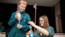 two scouts performing a science experiment